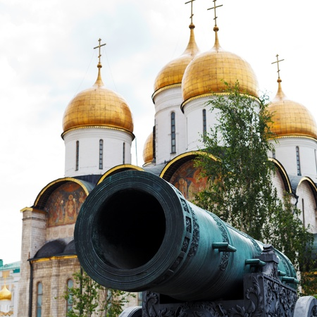 Tsar Cannon barrel and gold dome of Dormition Cathedral in Moscow Kremlin