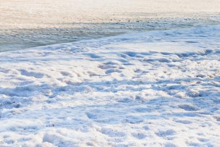 snowbound: snowbound riverbank of frozen river in spring morning