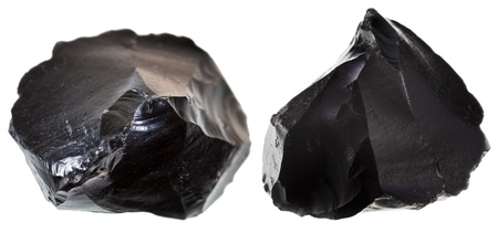 volcanic stones: st of black obsidian stone isolated on white background Stock Photo