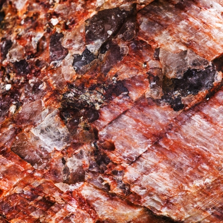 inclusions: macro view background from pink rock stone with crystalline inclusions Stock Photo