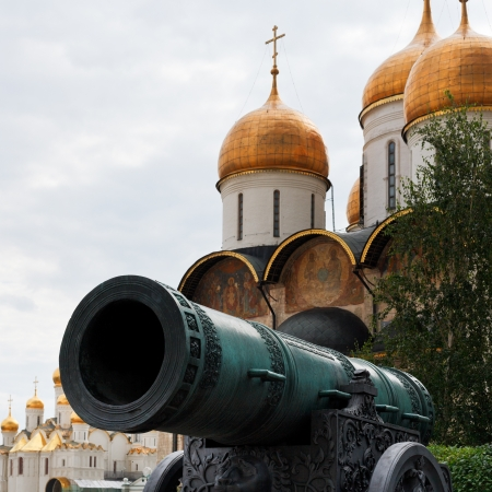 Tsar Cannon and gold dome of Dormition Cathedral in Moscow Kremlin photo