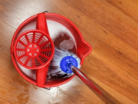 housecleaning: top view of mop in bucket with water for housecleaning Stock Photo