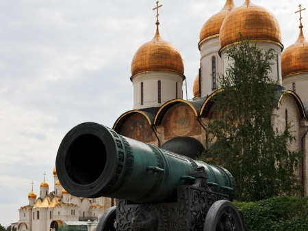 view of Tsar Cannon and gold dome of Dormition Cathedral in Moscow Kremlin