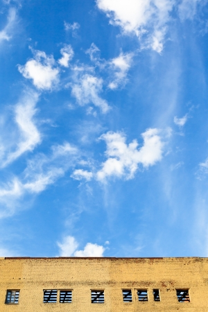 rehabilitated: blue sky with white cloud above furbished building in summer day Stock Photo