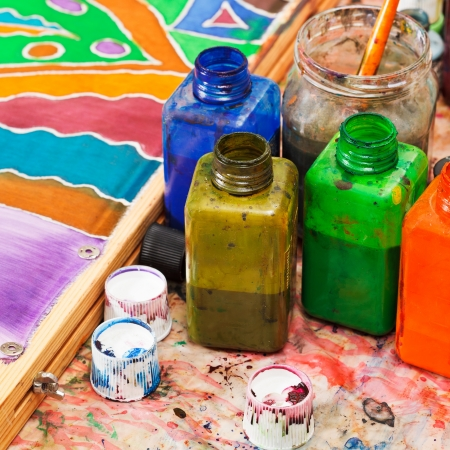 paintbrush and bottles with dyes for cold batik photo