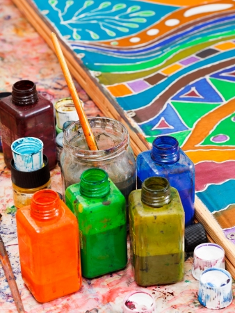 pigments: paintbrushes and bottles with pigments for cold batik