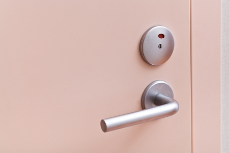 closed pink inner door with metallic handle photo