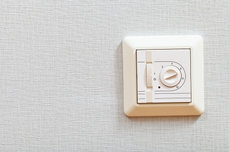 temperature controller: temperature controller of electric heating floor on room wall close up