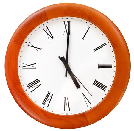 five o clock on round dial wall clock - end of working day photo
