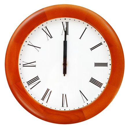 twelve o clock midnight on the round wall clock photo
