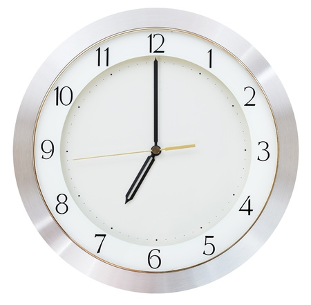 seven o clock on the dial round wall clock photo