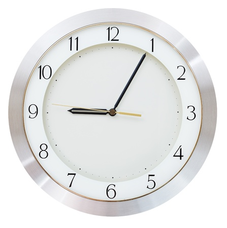nine o clock and five minutes on the clock face round wall clock photo