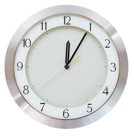 five to twelve: Five minutes after midnight (after twelve hours) on the dial round wall clock Stock Photo