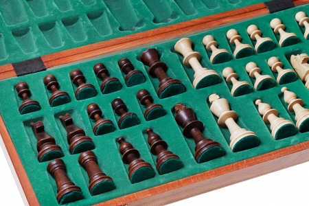 set of chess pieces packed in box close up photo