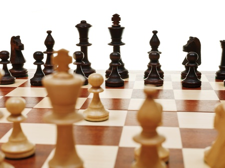 view from king of first move pawn on chess board close up photo