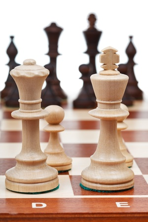 view of set of chess pieces from king and queen close up photo