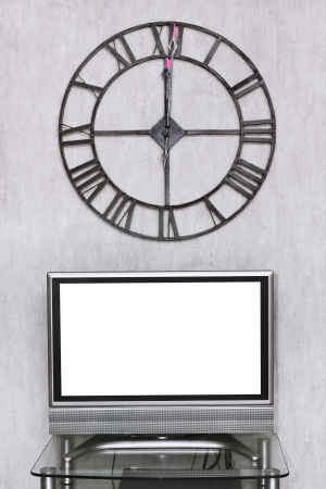 mitnight time on wall clock under blank white screen of TV set photo