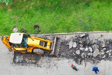 top view of tractor removes asphalt from road Stock Photo - 21346931