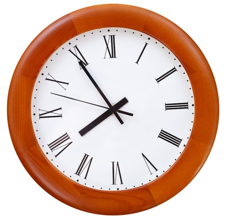 five minutes to eight o clock on round dial clock photo