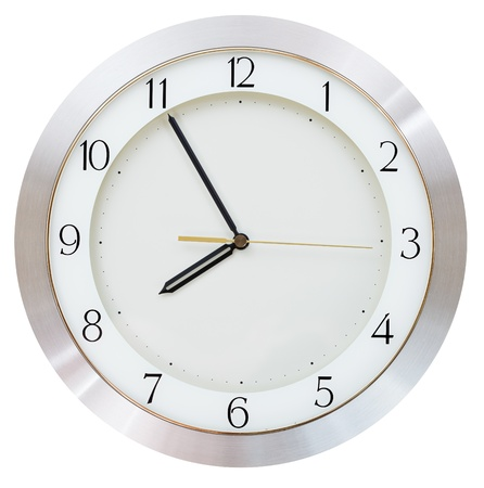 wall clock: five minutes to eight o clock on the dial round wall clock