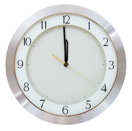 one minute to twelve o clock on the dial round wall clock photo