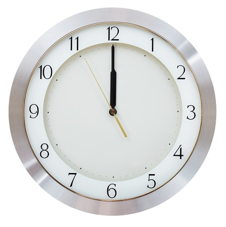 five to twelve: without five seconds twelve o clock on the dial round wall clock Stock Photo