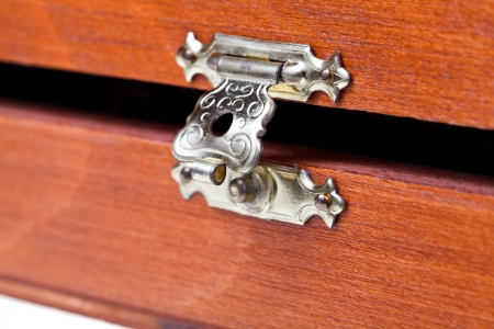 open metal lock of wooden case close up photo
