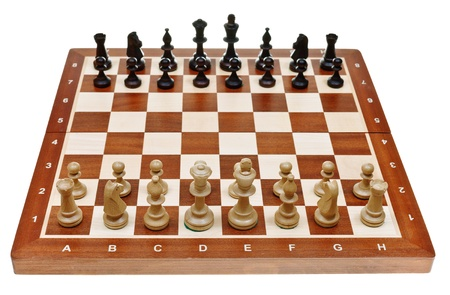 chess pieces placed on chessboard isolated on white background Stock Photo - 21515349