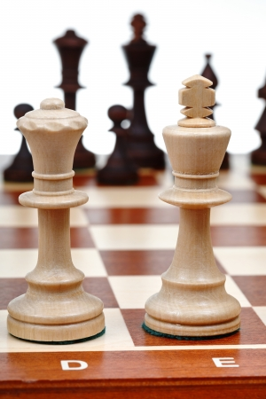 view of set of chess pieces from the king and queen close up photo