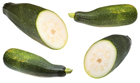 set of green zucchini isolated on white background photo