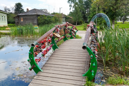 tripped: DMITROV, RUSSIA - AUGUST 14: Bridge of lovers and luck horseshoe in Dmitrov, Russia on August 14, 2013. According to legend horse of Prince Yuri Dolgoruky tripped over rock and broke horseshoe here