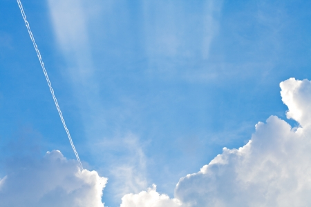 stratus: cloudscape with trace of air plane in blue sky in summer evening