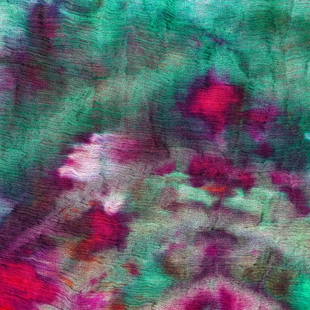 nodular: abstract stained green and magenta pattern of nodular batik painted on silk