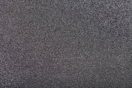 emery paper: background from surface of abrasive paper close up