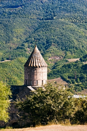 tower of St. G. Lusavorich church in medieval Tatev Monastery in Armenia photo