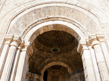 tatev: decoration of gate to cathedral of st. pogos and petros in Tatev Monastery in Armenia