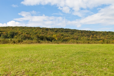 anomalous: green meadow at foot of caucasian mountains in Shapsugskaya anomalous area in early autumn day