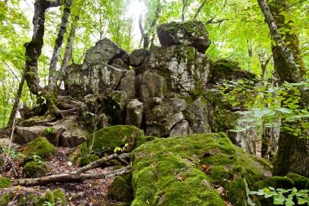 anomalous: Rock Devil finger - landmark in shapsugskaya anomalous zone in caucasus mountains Stock Photo