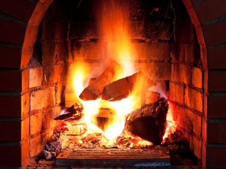 flames of fire in fireplace in evening time Stock Photo - 22652888
