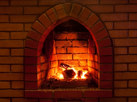firebox: flames of fire in fireplace in evening time Stock Photo
