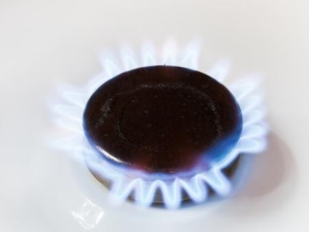 normative: burning gas in range burner of kitchen stove