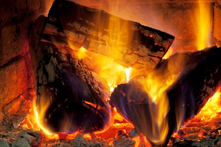 burning wood in fireplace in evening time photo