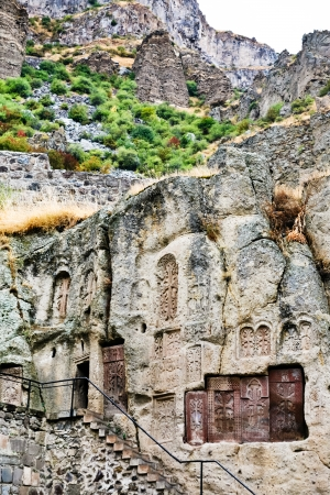 geghard: steps, chapel and khachkar carved cross-stones in medieval geghard monastery in Armenia Stock Photo