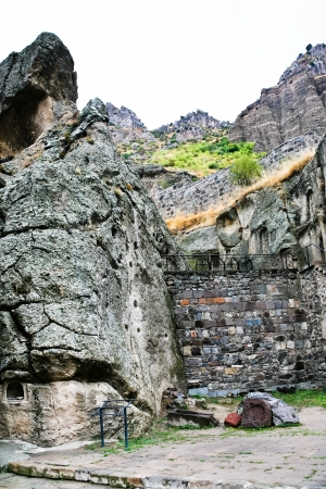ancient stone walls of medieval geghard monastery in Armenia photo