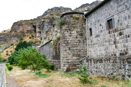 geghard: outer stone walls of medieval geghard monastery in Armenia