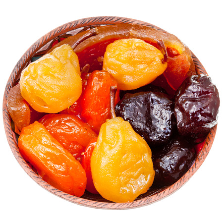 armenian sugared sweet fruits in ceramic bowl isolated on white background photo