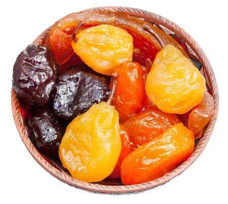armenian sugared sweet fruits in ceramic bowl isolated on white background