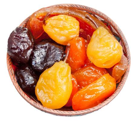 armeno frutta zuccherato dolce in ciotola in ceramica isolato su sfondo bianco Archivio Fotografico