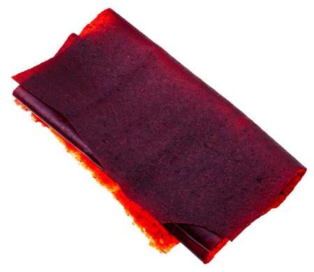 alycha: georgian cuisine - dried mashed pulp of tkemali cherry plum isolated on white background Stock Photo