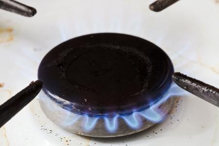 municipal utilities: burning gas in burner ring of kitchen stove